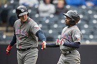 Lehigh Valley IronPigs outfielder Roman Quinn (2) is greeted by teammate Ryhs Hoskins (12) after he scored against the Toledo Mud Hens during the International League baseball game on April 30, 2017 at Fifth Third Field in Toledo, Ohio. Toledo defeated Lehigh Valley 6-4. (Andrew Woolley/Four Seam Images)