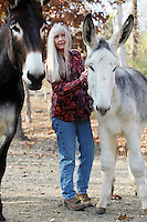 Deb Kidwell grooms Lake Nowhere Eden, an American Mammoth Jackstock, on Saturday, Nov. 20, 2010 at Lake Nowhere Mule and Donkey Farm in Martin, Tenn. Kidwell breeds American Mammoth Jackstock, the only American breed of Ass, and one started by George Washington. With only an estimated 2,000 left in existence, the breed is dying off with the mechanization of farm equipment.