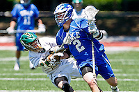 April 30, 2011:   Duke Blue Devils midfielder David Lawson (2) tries to escape the stick or a Jacksonville Dolphins defender duringlacrosse action between the Duke Blue Devils and Jacksonville Dolphins at D. B. Milne Field in Jacksonville, Florida.  Duke defeated Jacksonville 10-6.