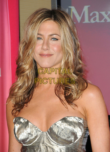 JENNIFER ANISTON .at The Women in Film 2009 Crystal .and Lucy Awards held at The Hyatt Regency Century Plaza in Century City, California, USA, June 12th 2009                                                                     .portrait headshot gold silver metallic shiny bustier cleavage strapless hair down wavy .CAP/DVS.©Debbie VanStory/RockinExposures/Capital Pictures