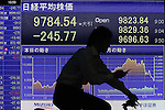 May 21, 2010 - Tokyo, Japan - A man rides his bicycle in front of an electric quotation board at the Tokyo Stock Exchange in Tokyo, Japan, on May 21, 2010. Japan's finance minister Friday hinted at possible government action to prevent any further rises in the yen. The yen touched a two-week high of 88.95 yen against the dollar Friday and 109.47 yen against the euro Thursday amid Europe's escalating debt crisis.