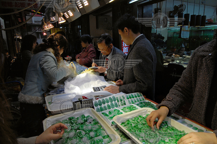 One of a thousand stalls, in an alley at Hualin Jade Products market, the largest jade market in China.