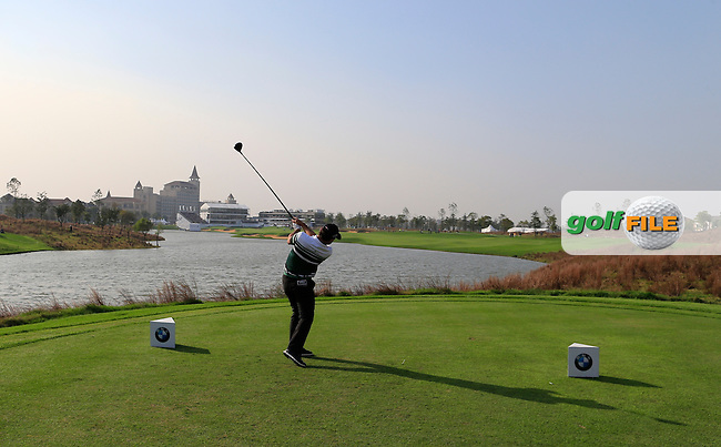 Fabrizio Zanotti (PAR) tees off the 18th tee during Sunday's Final Round of the 2014 BMW Masters held at Lake Malaren, Shanghai, China. 2nd November 2014.<br /> Picture: Eoin Clarke www.golffile.ie