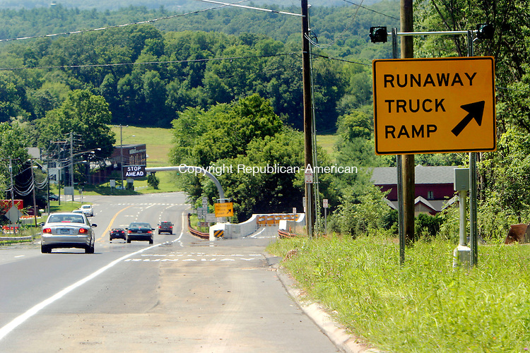 AVON, CT - 07 JULY 2008 -071508JS01-Cars drive down Route 44 in Avon past the runaway truck ramp on Tuesday. The runaway truck ramp was put in place following a dump truck crash at the bottom of the hill in 2005.<br /> Jim Shannon Republican-American.