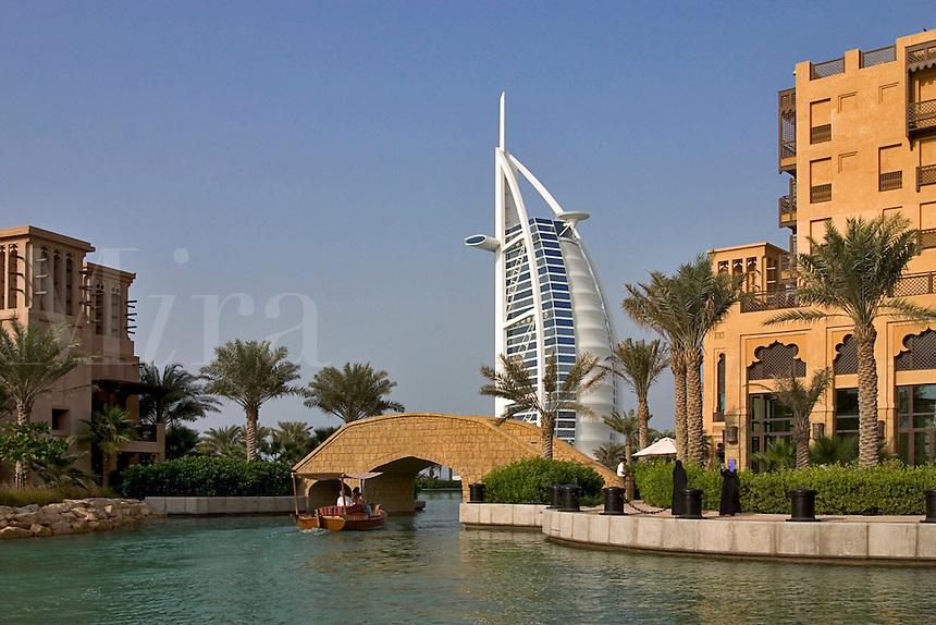 Dubai, United Arab Emirates. Madinat Jumeirah. Burj al Arab Hotel and Mina A'Salam Hotel seen from the Souk/bazaar. Water taxi, abra..