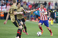Atletico de Madrid´s Filipe Luis (R) and Milan´s Kaka during 16th Champions League soccer match at Vicente Calderon stadium in Madrid, Spain. March 11, 2014. (ALTERPHOTOS/Victor Blanco)