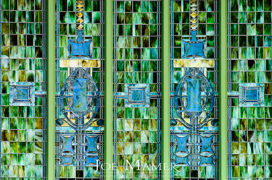 "Exterior window detail of the National Farmers' Bank of Owatonna, Minnesota. .The bank was built in 1908. Designed by Louis Sullivan with decorative elements by George Elmslie it was the first of Sullivan's ""jewel boxes"". The windows were designed by Louis J. Millet.."