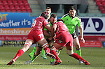 No way through for Munster hooker Kevin O'Byrne as Scarlets pair George Earle and Lewis Rawlins close in.<br /> Guiness Pro12<br /> Scarlets v Munster<br /> 21.02.15<br /> ©Steve Pope -SPORTINGWALES