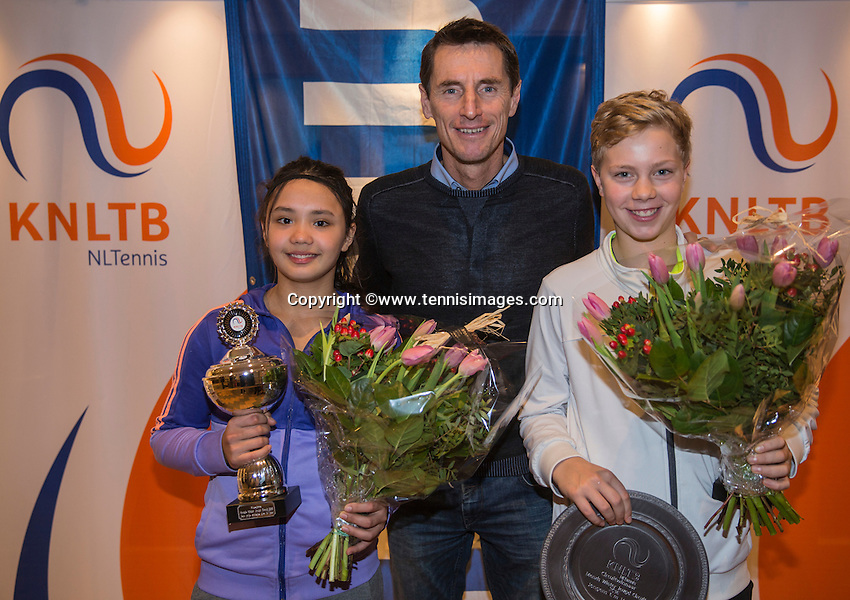Hilversum, Netherlands, December 4, 2016, Winter Youth Circuit Masters Overall winner  boys 14 years Bastiaan Weststrate  and girls Marwa Hakimi with Fedcup  captain Paul Haarhuis.<br /> Photo: Tennisimages/Henk Koster