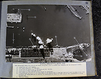 BNPS.co.uk (01202 558833)<br /> Pic:  Tooveys/BNPS<br /> <br /> Taken on 15/10/41 - An attack on shipping at docks at Le Havre.<br /> <br /> Dramatic photos showing a series of heart-pounding World War Two bombing raids from the pilot's perspective have come to light.<br /> <br /> They were taken from Blenheim bombers undertaking attacks on targets in Germany and Nazi-occupied Netherlands in 1941.<br /> <br /> Several capture the immediate aftermath of a direct hit, with flames and clouds of smoke signifying they had achieved their aim.<br /> <br /> The album, which contains almost 100 photos, has emerged for sale with Toovey's Auctions, of Washington, west Sussex.
