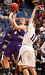 SIOUX FALLS, SD - MARCH 10:  Michelle Maher #14 from Western Illinois shoots over Amanda Hyde #11 from IPFW during overtime of their quarterfinal game Sunday afternoon at the 2013 Summit League Championships in Sioux Falls, SD.  (Photo by Dave Eggen/Inertia)