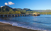 People enjoy a misty morning at Hanalei Pier and Bay, as seen from Black Pot Beach, Kaua'i.