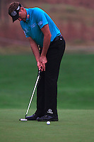 Ian Poulter (ENG) putts on the 1st green during Thursday's Round 1 of the 2014 BMW Masters held at Lake Malaren, Shanghai, China 30th October 2014.<br /> Picture: Eoin Clarke www.golffile.ie