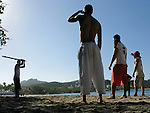 Dominican boys play baseball on a beach, Confresi, Dominican Republic