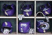 LSU Tigers helmet rack at the NCAA College World Series on June 14, 2015 at TD Ameritrade Park in Omaha, Nebraska. TCU defeated LSU 10-3. (Andrew Woolley/Four Seam Images)