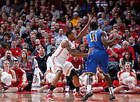 Ohio State Buckeyes guard Lenzelle Smith Jr. (32) defends Delaware Blue Hens guard Devon Saddler (10) during the first half of the NCAA men's basketball game at Value City Arena on Wednesday, December 18, 2013. (Columbus Dispatch photo by Jonathan Quilter)