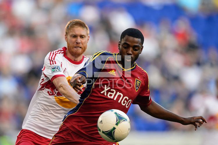 Aaron Maund (4) of Real Salt Lake is marked by Markus Holgersson (5) of the New York Red Bulls. The New York Red Bulls defeated Real Salt Lake 4-3 during a Major League Soccer (MLS) match at Red Bull Arena in Harrison, NJ, on July 27, 2013.