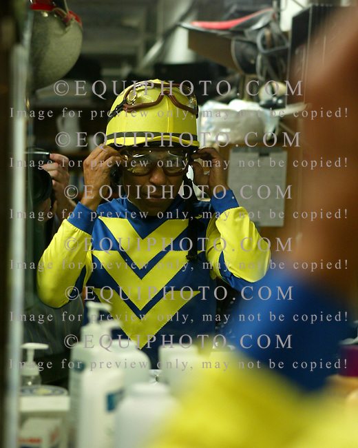 62 year old Hall Of Fame Jockey Angel Cordero, Jr. adjusts his goggles in the jockeys quarters at Philadelphia Park before riding Indian Vale to a fifth place finish in the $300,000 Cotillion Handicap.  Cordero, was making a one race comeback to raise funds for Hurricane Katrina victims.  10/1/05 Photo By Bill Denver/EQUI-PHOTO.