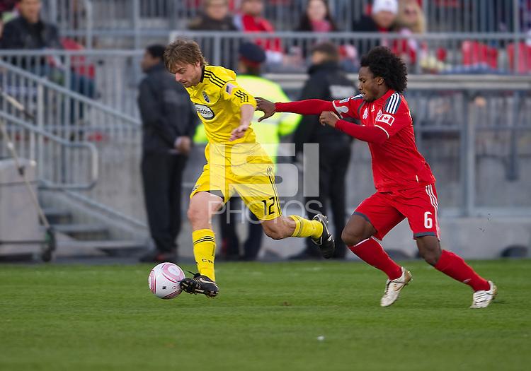 October 16 2010 Columbus Crew midfielder/forward Eddie Gaven #12 and Toronto FC midfielder Julian de Guzman #6 in action during a game between the Columbus Crew and Toronto FC at BMO Field in Toronto..The final score was a 2-2 draw.