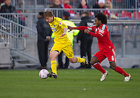 October 16 2010 Columbus Crew midfielder/forward Eddie Gaven #12 and Toronto FC midfielder Julian de Guzman #6 in action during a game between the Columbus Crew and Toronto FC at BMO Field in Toronto..The final score was a 2-2 draw.