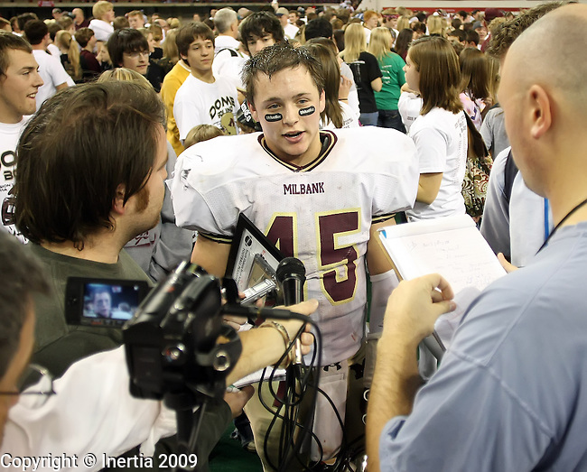 VERMILLION, SD - NOVEMBER 12: Most valuable player, Colin Porath #45 of Milbank speaks with the media after the Bulldogs defeated the St. Thomas More Cavaliers 34-20 in the South Dakota Class 11A Championship game Thursday, November 12, 2009 at the DakotaDome in Vermillion, SD. (Photo by Dave Eggen/Inertia)