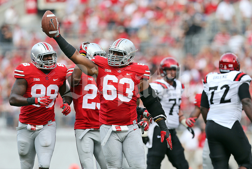 Ohio State Buckeyes defensive lineman Michael Bennett (63) comes up with the ball after forcing a fumble while sacking San Diego State Aztecs quarterback Quinn Kaehler (18) during the second quarter of the NCAA football game against San Diego State at Ohio Stadium in Columbus on Sept. 7, 2013. (Adam Cairns / The Columbus Dispatch)