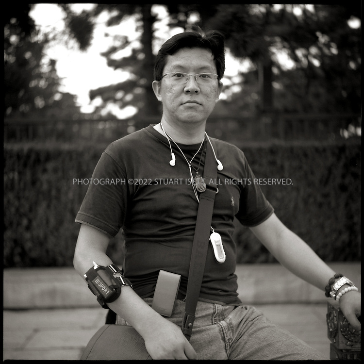 6/26/2005--Beijing, China..Gao Shengyan, 38, from Taiwan waiting outside Mao's Mausoleum on Tiananmen Square. ..Photograph By Stuart Isett.All photographs ©2005 Stuart Isett.All rights reserved.