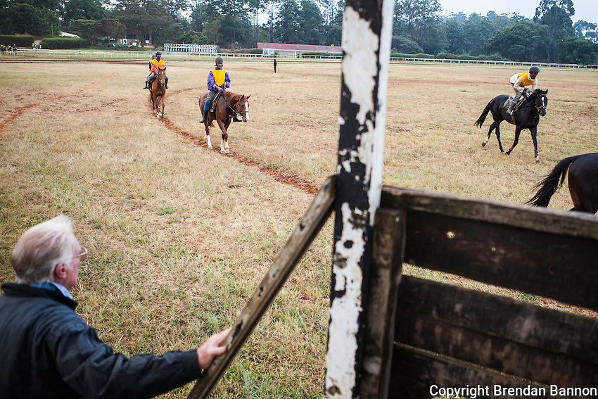 Former pilot and jockey Tony Abercrombie-Dick, watches horses prepare for work on the gallops early in the morning at Ngong Racecourse in Nairobi, Kenya. March 13, 2013. Photo: Brendan Bannon