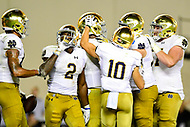 Blacksburg, VA - OCT 6, 2018: Notre Dame Fighting Irish players celebrate a touchdown late in the 4th quarter of game between Notre Dame and Virginia Tech at Lane Stadium/Worsham Field Blacksburg, VA. (Photo by Phil Peters/Media Images International)