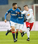 Jon Toral uses his strength to muscle hs opponent away