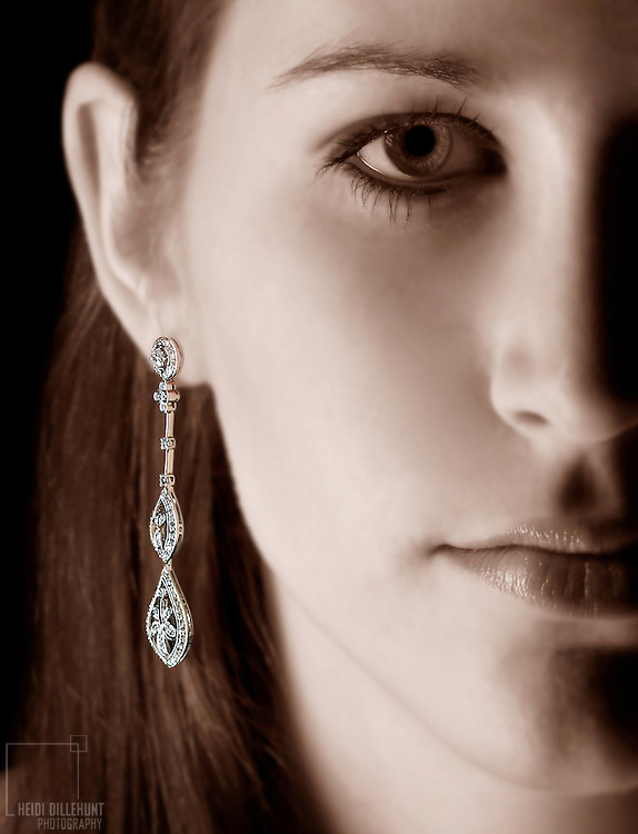Half portrait of a girl with earring, red toned