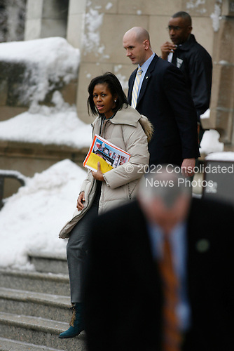 Chicago, IL - December 19, 2008 -- First lady in waiting Michelle Obama exits the University of Chicago Laboratory Schools where her daughters attend school Friday morning, December 19, 2008.  .Credit: Anne Ryan - Pool via CNP