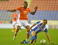 Blackpool's Jamille Matt battles with Wigan Athletic's Alex Gilbey<br /> <br /> Photographer Dave Howarth/CameraSport<br /> <br /> The Carabao Cup - Wigan Athletic v Blackpool - Tuesday 8th August 2017 - DW Stadium - Wigan<br />  <br /> World Copyright &copy; 2017 CameraSport. All rights reserved. 43 Linden Ave. Countesthorpe. Leicester. England. LE8 5PG - Tel: +44 (0) 116 277 4147 - admin@camerasport.com - www.camerasport.com