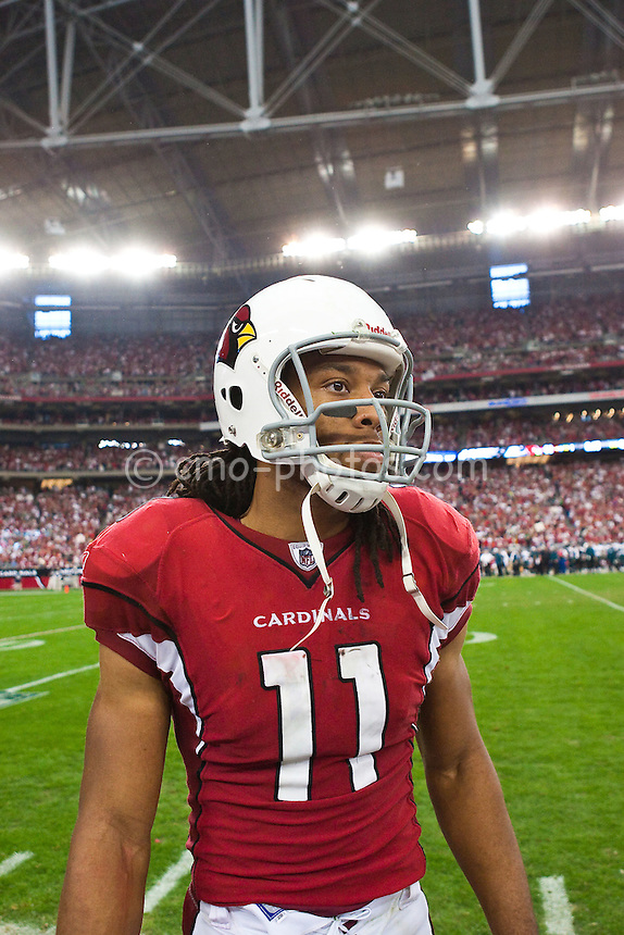 Jan 18, 2009; Glendale, AZ, USA; Arizona Cardinals wide receiver Larry Fitzgerald (11) paces along the sidelines while the Cardinals defense secures victory in the NFC Championship Game against the Philadelphia Eagles at University of Phoenix Stadium.  The Cardinals won the game 32-25 to advance to Super Bowl XLIII.