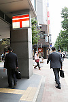 Pedestrinas walk past a post mail sign in Shinjuku district on October 29, 2015, Tokyo, Japan. The share price for Japan Post Holdings Co. public offering was set at 1,400 yen (11.58) for its debut on the Tokyo Stock Exchange next November 4. This price was at the high end of expectations and the government hopes that many Japanese citizens will take the opportunity to invest in the company. (Photo by Rodrigo Reyes Marin/AFLO)