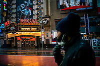 NEW YORK, NY - April 13:  A man walks around local stores that remain shuttered due to COVID-19 at Times Square on April 13, 2020. in New York, United States. The global economy is facing the worst collapse since the WWII, while COVID-19  pandemic has now killed more than 22,000 people in the United States and at least 1,864,629 people died world wide. (Photo by Eduardo MunozAlvarez/VIEWpress)