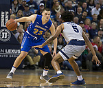 South Dakota State guard Owen King (23) dribbles around         Nevada's Nisre Zouzoua (5) in the scond half of an NCAA college basketball game in Reno, Nev., Saturday, Dec. 15, 2018. (AP Photo/Tom R. Smedes)