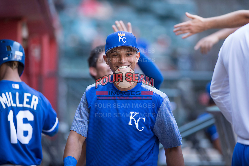 Kansas City Royals outfielder Anderson Miller (16) laughs after congratulating MJ Melendez, who hit a single while wearing Miller's #16 jersey, during an Instructional League game against the Arizona Diamondbacks at Chase Field on October 14, 2017 in Scottsdale, Arizona. (Zachary Lucy/Four Seam Images)