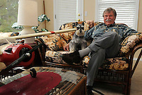 STAFF PHOTO FLIP PUTTHOFF <br /> Ken Bethe of Bella Vista and his dog, Fritz, with a model of a DeHavilland Beaver, this one with wheels, not pontoons. Bethe spends summers as a float-plane pilot in Alaska flying hunters, anglers and sight-seers to the wonders of the 49th state.
