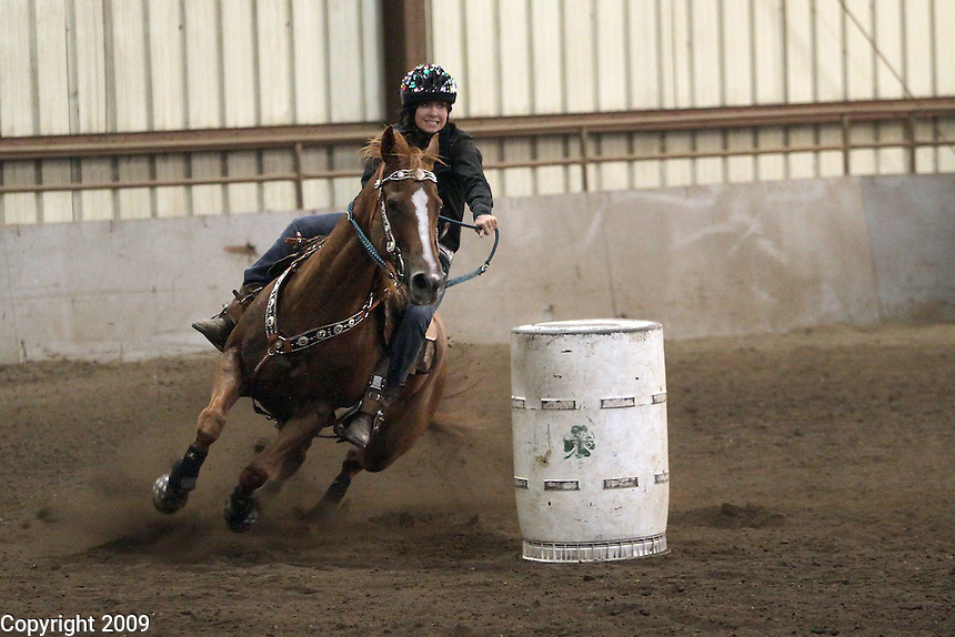Haley Van Beek, 13, from Everson, and Jewel achieve their gold medal in the Texas Barrel race. She is in the 4-H group Blazing Saddles-NW Washington Fair. August 21, 2009 PHOTOS BY MERYL SCHENKER ..