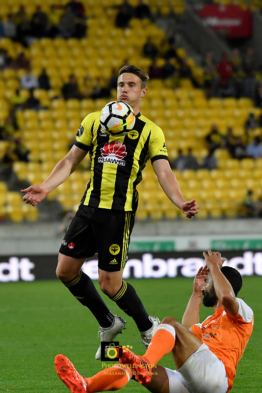 Wellington Phoenix' Dylan Fox and Brisbane&rsquo;s Fahid Ben Khalfallah in action during the A League - Wellington Phoenix v Brisbane Roar FC at Westpac Stadium, Wellington, New Zealand on Saturday 28 October.<br /> Photo by Masanori Udagawa. <br /> www.photowellington.photoshelter.com