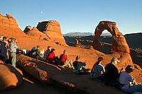 Visitors at Delicate Arch, Arches National Park, near Moab, Utah