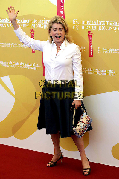 CATHERINE DENEUVE.Jury photo call on the first day of the 63rd Venice Film Festival, Venice, Italy..August 30th, 2006.Ref: OME.full length white shirt black skirt purse bag hand arm waving.www.capitalpictures.com.sales@capitalpictures.com.©Omega/Capital Pictures.