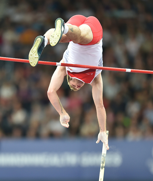 England's Luke Cutts competes in the men's pole vault final where he claimed a silver medal<br /> <br /> Photographer Chris Vaughan/CameraSport<br /> <br /> 20th Commonwealth Games - Day 9 - Friday 1st August 2014 - Athletics - Hampden Park - Glasgow - UK<br /> <br /> &copy; CameraSport - 43 Linden Ave. Countesthorpe. Leicester. England. LE8 5PG - Tel: +44 (0) 116 277 4147 - admin@camerasport.com - www.camerasport.com