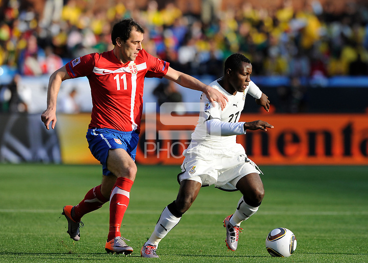 Kwadwo Asamoah of Ghana and Nenad Milijas of Serbia