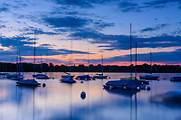 Blurred sailboats at dawn on Lake Harriet in Minneapolis, Minnesota.