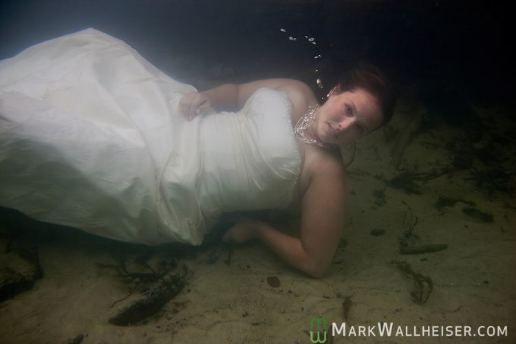 Amanda Nalley and husband John Stubbs enjoy the Wakulla River in their wedding attire August 26, 2011.