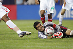 June 08 2008:  Oswaldo Sanchez (Santos) (ground) goalie of Mexico bats the ball away from his goal.  During the third and final match of Mexico's 2008 USA Tour in preparation for qualification for FIFA's 2010 World Cup, the national soccer team of Mexico defeated Peru 4-0 at Soldier Field, in Chicago, IL.