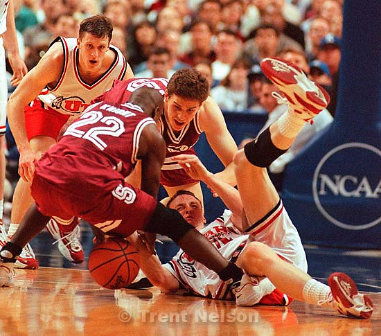 Keith Van Horn on the floor fighting for the ball with Brevin Knight and Mark Madsen at Utah vs Stanford, NCAA Tournament.<br />