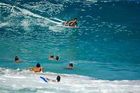 bodyboarding during large surf at Magic sands beach Kailua Kona The Big Island of Hawaii